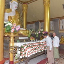 Gold foils offered for second time at the whole structure of historic Shwetaungsar Pagoda, Yadana diamond orb, pennant-shaped vane hoisted atop the pagoda in Dawei