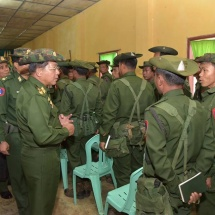 Senior General Min Aung Hlaing cordially meets servicemen and wives from local battalion headquarters in Shaduzup Village in Tanai Township for their brave combats on KIA insurgents who attacked the headquarters of the local battalion
