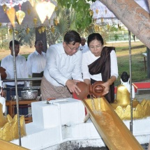 Senior General Min Aung Hlaing, wife Daw Kyu Kyu Hla,families of the Office of Commander-in-Chief (Army, Navy and Air)water Maha Bodhi banyan trees on full moon day of Kason