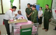 Senior General Min Aung Hlaing gives words of encouragement to UWSA (Wa) Group Vice Chairman U Pauk Yu Yi receiving medical treatment at General Hospital (1000-bed) in Nay Pyi Taw