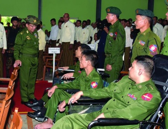 Senior General Min Aung Hlaing addresses ceremony to hand over apartments of advanced War Veterans Housing (Yangon-1/2) in Myaingthaya and Kyetphyukan and E-Bike powered wheelchairs