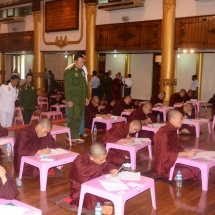 Senior General Min Aung Hlaing, wife Daw Kyu Kyu Hla and family offer day meal to monks, novices and nuns taking the 31st Sasanawunhsaung Thamanekyaw oral exam