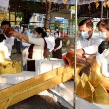 Senior General Min Aung Hlaing, wife Daw Kyu Kyu Hla, senior military officers of Office of Commander-in-Chief (Army, Navy and Air) and wives pour water at banyan trees on full moon day of Kason