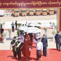 Conveyance ceremony of part-1 of Bhumi Phassa Mudra Sitting Buddha Image by Pyigyimon Yadana decorated float flanked by royal boat entourage launched