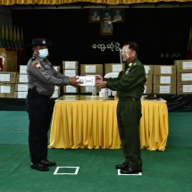 Senior General Min Aung Hlaing presents honorary cash awards to security forces for their effective anti-drug drive in Tachilek and health aids for COVID-19 prevention, control and treatment