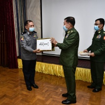 Senior General Min Aung Hlaing presents cash awards to Myanmar Police Force members who made achievements in effective anti-narcotic measures in Shan State