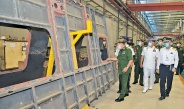 Chairman of State Administration Council Commander-in-Chief of Defence Services Senior General Min Aung Hlaing inspects passenger coach and wagon factory of Myanma Railways in Myitnge